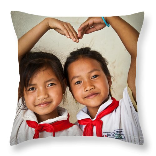 Child Throw Pillow featuring the photograph Two Lao Girls With Red Scarfs by Jo Ann Tomaselli