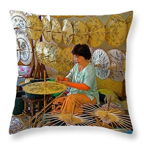 Umbrella Maker At Borsang Umbrella And Paper Factory In Chiang Mai Throw Pillow featuring the photograph Umbrella Maker At Borsang Umbrella And Paper Factory In Chiang Mai-thailand by Ruth Hager