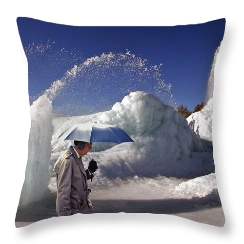 Umbrella Man Throw Pillow featuring the photograph Umbrella Man At Frozen Fountain by Christopher McKenzie