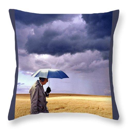 Umbrella Man Throw Pillow featuring the photograph Umbrella Man In Kansas Wheat Field by Christopher McKenzie