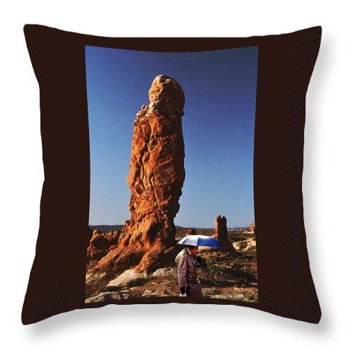 Umbrella Man Throw Pillow featuring the photograph Umbrella Man In The Desert by Christopher McKenzie