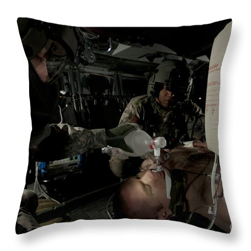 Army Throw Pillow featuring the photograph U.s. Army Medics Simulating Ventilation by Terry Moore
