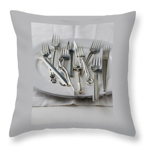 Kitchen Throw Pillow featuring the photograph Various Forks On A Plate by Romulo Yanes