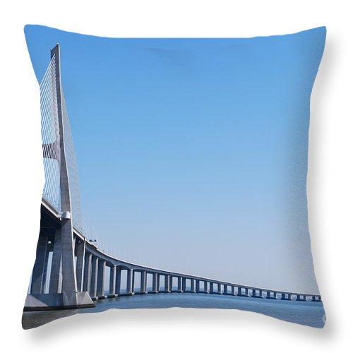 Bridge Throw Pillow featuring the photograph Vasco Da Gama Bridge In Lisbon by Luis Alvarenga