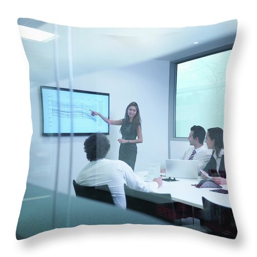 Working Throw Pillow featuring the photograph View Through Glass Wall Of Business by Monty Rakusen