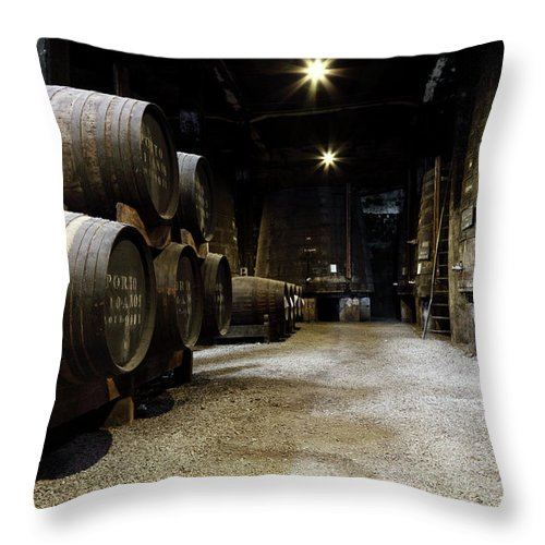 Desaturated Throw Pillow featuring the photograph Vintage Porto Wine Cellar by Vuk8691