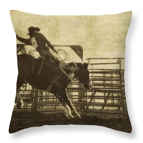 Rodeo Throw Pillow featuring the photograph Vintage Saddle Bronc Riding by Priscilla Burgers