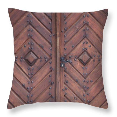 Material Throw Pillow featuring the photograph Vintage Wooden Brown Door Close-up by Bogdan Khmelnytskyi