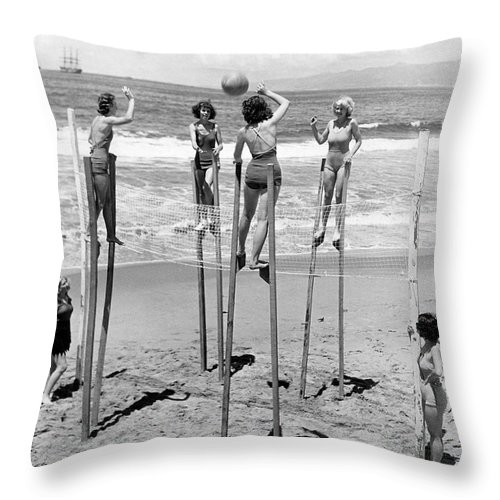 1930's Throw Pillow featuring the photograph Volleyball On Stilts by Underwood Archives