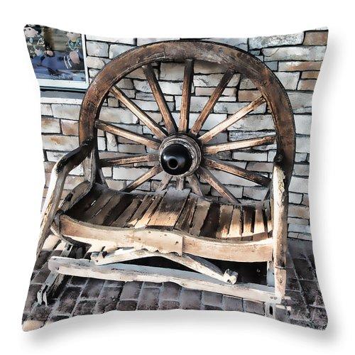 Scottsdale Az Throw Pillow featuring the photograph Wagon Wheel Chair by Melvin Busch