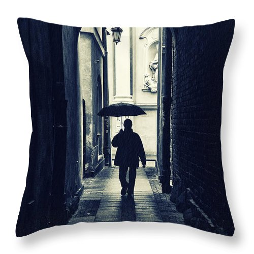 Weather Throw Pillow featuring the photograph Walking In The Rain by Jaroslaw Blaminsky