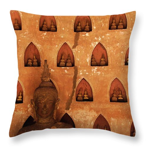 Wall Of Buddhas Throw Pillow featuring the photograph Wall Of Buddhas by Bob Christopher