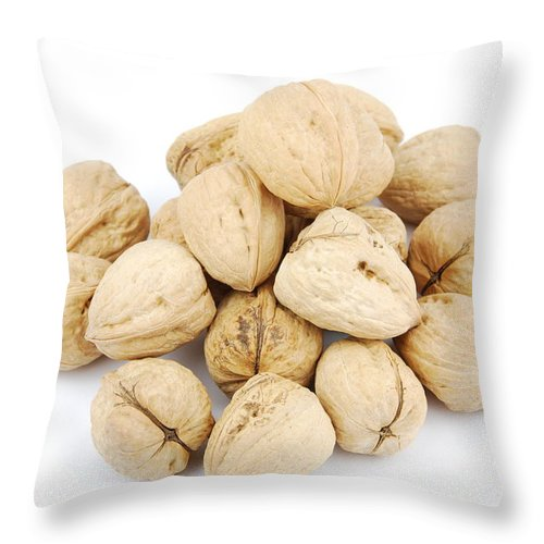 Walnut Throw Pillow featuring the photograph Walnuts by Luis Alvarenga