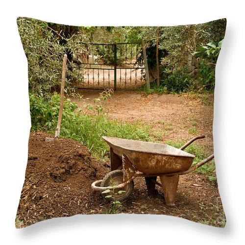Garden Throw Pillow featuring the photograph Wheel Barrow Next To Soil Heap by Leyla Ismet
