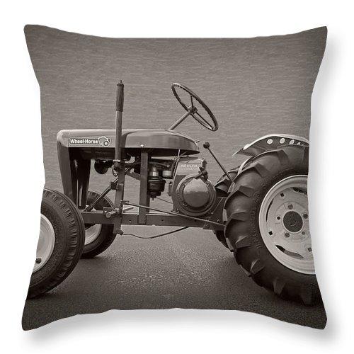 Garden Throw Pillow featuring the photograph Wheel Horse Vintage by Debra and Dave Vanderlaan