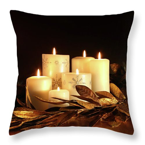 Background Throw Pillow featuring the photograph White Candles With Gold Leaf Garland by Sandra Cunningham