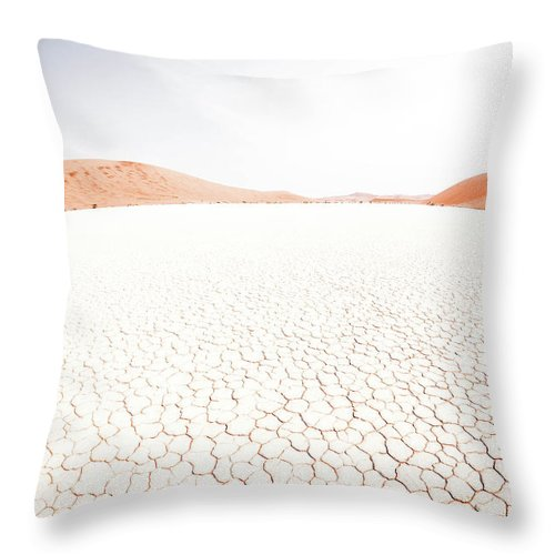 Tranquility Throw Pillow featuring the photograph White Clay Pan And Dunes by Taken By Chrbhm