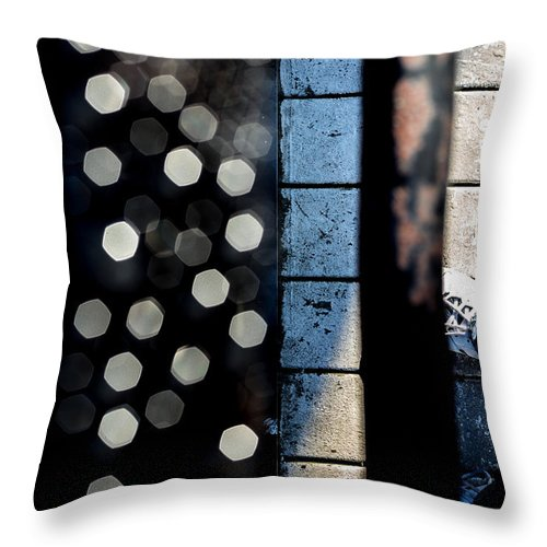 Abstract Throw Pillow featuring the photograph White Sneakers On The Edge by Bob Orsillo