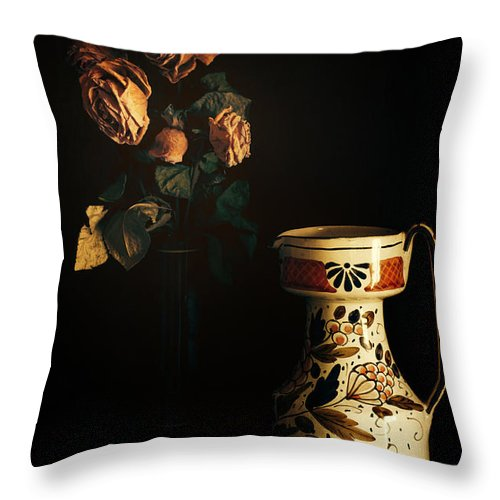 Chiaroscuro Throw Pillow featuring the photograph Wilted Roses With Italian Vase by Silvia Ganora