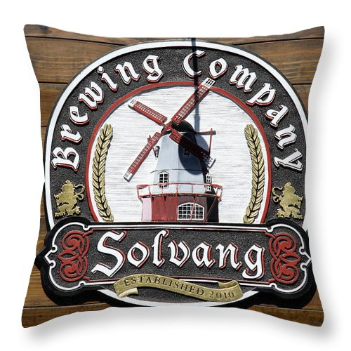 Wind Mill Throw Pillow featuring the photograph Wind Mill Brewery Sign by Christiane Schulze Art And Photography