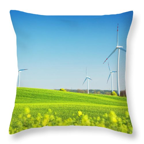 Wind Throw Pillow featuring the photograph Wind Turbines On Spring Field by Michal Bednarek