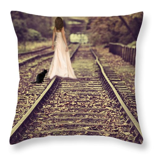Woman Throw Pillow featuring the photograph Woman On Railway Line by Amanda Elwell