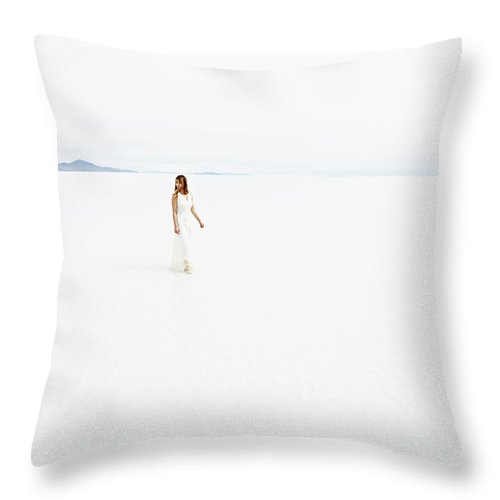 Scenics Throw Pillow featuring the photograph Woman Wearing Dress Walking Through by Thomas Barwick