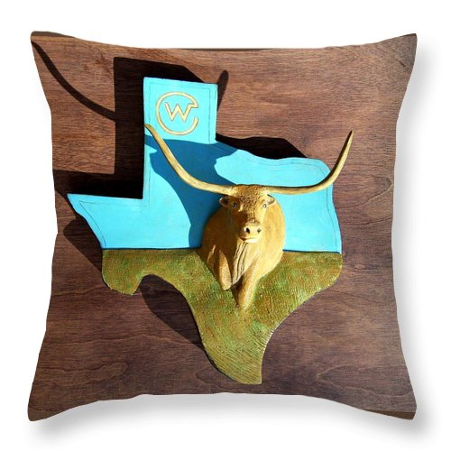 Longhorn Throw Pillow featuring the sculpture Woodcrafted Home on the Range by Michael Pasko