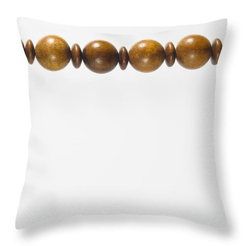 Accessory Throw Pillow featuring the photograph Wooden Beads Necklace by Alain De Maximy
