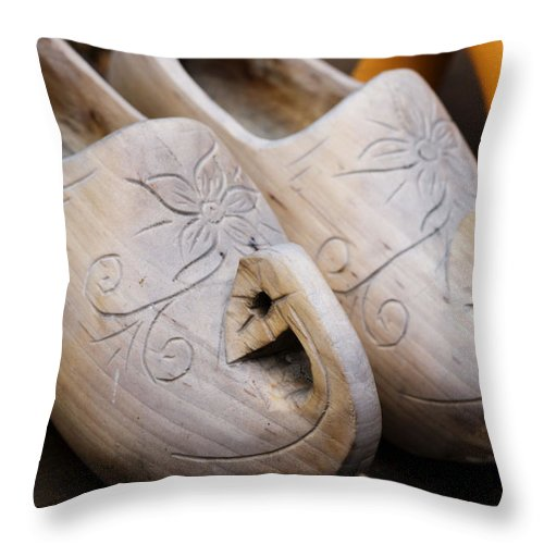 Clogs Throw Pillow featuring the photograph Wooden Clogs by Juli Scalzi