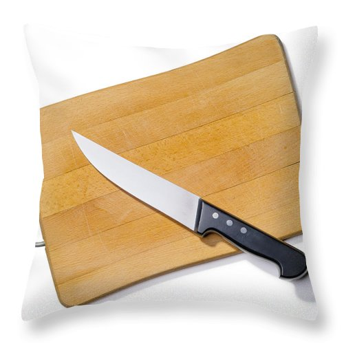 Above Throw Pillow featuring the photograph Wooden Cutting Board With Kitchen Knife by Alain De Maximy