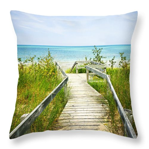 Beach Throw Pillow featuring the photograph Wooden Walkway Over Dunes At Beach by Elena Elisseeva