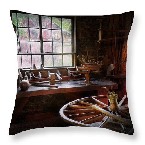 Carpenter Throw Pillow featuring the photograph Woodworker - The Wheelwright Shop by Mike Savad