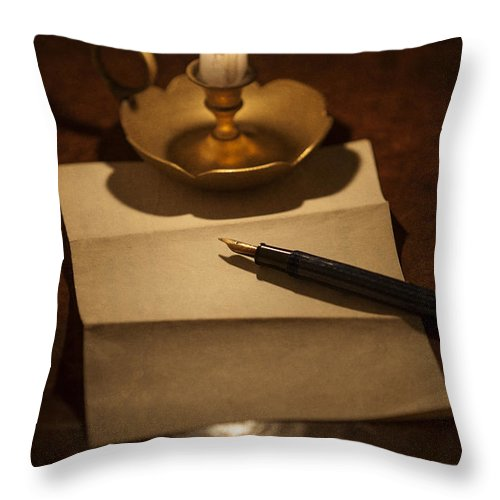 Candle Throw Pillow featuring the photograph Writing A Letter By Candle Light by Lee Avison