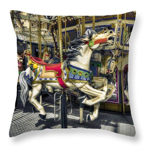 Fun Throw Pillow featuring the photograph Xmas Carousel by Wayne Sherriff