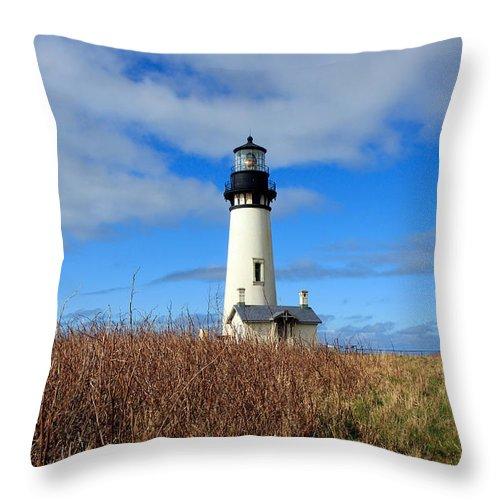 Yaquina Bay Lighthouse Throw Pillow featuring the photograph Yaquina Bay Lighthouse In Oregon by Athena Mckinzie