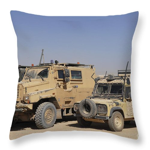 4x4 Throw Pillow featuring the photograph A British Armed Forces Snatch Land by Andrew Chittock