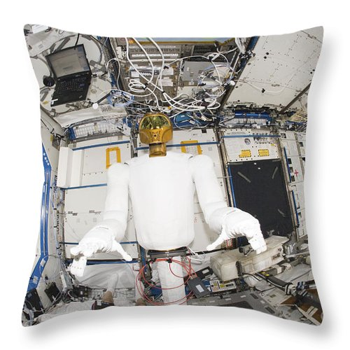 Color Image Throw Pillow featuring the photograph A Humanoid Robot In The Destiny by Stocktrek Images
