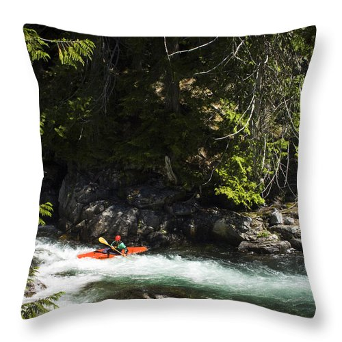 Usa Throw Pillow featuring the photograph A Kayaker Paddles In A Rapid As Seen by Michael Hanson