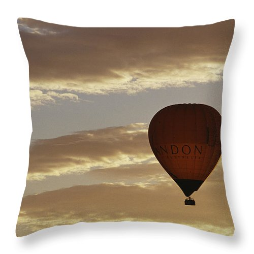 Clouds Throw Pillow featuring the photograph A Soaring Hot Air Balloon by Jason Edwards