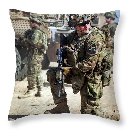 Operation Enduring Freedom Throw Pillow featuring the photograph A U.s. Army Soldier Provides Security by Stocktrek Images