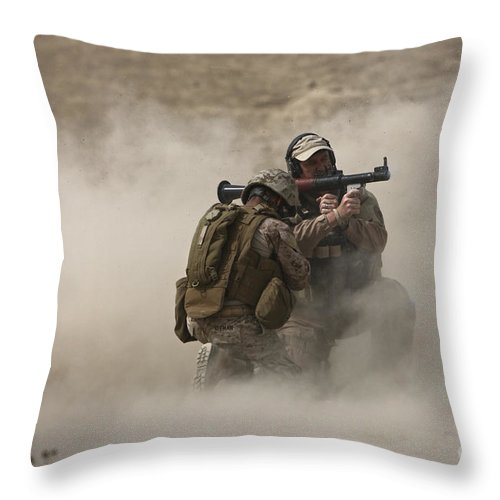 Afghanistan Throw Pillow featuring the photograph A U.s. Contractor Fires by Terry Moore