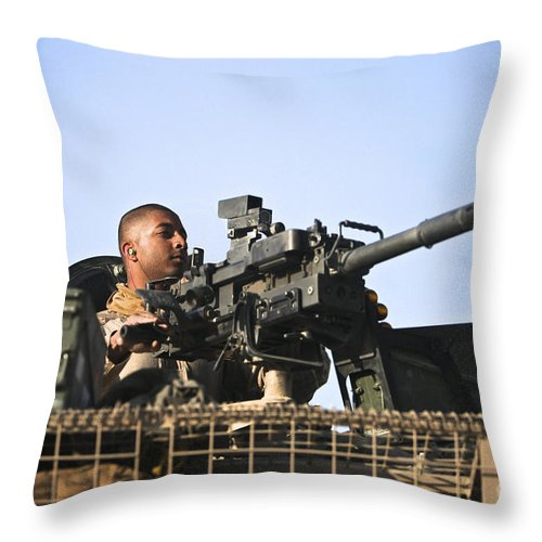 Isaf Throw Pillow featuring the photograph A U.s. Marine Fires A Gmg Automatic by Terry Moore