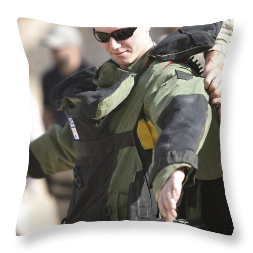 Operation Enduring Freedom Throw Pillow featuring the photograph A U.s. Marine Gets Suited by Terry Moore