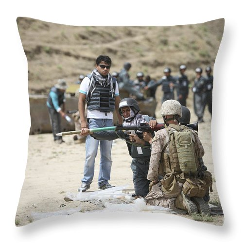 Afghanistan Throw Pillow featuring the photograph An Afghan Police Student Loads A Rpg-7 by Terry Moore