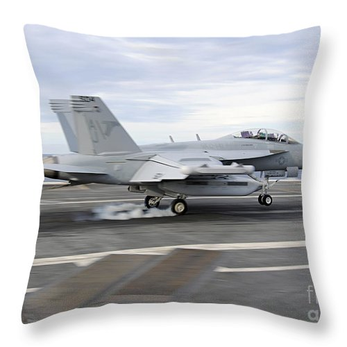 Ea-18g Growler Throw Pillow featuring the photograph An Ea-18g Growler Makes An Arrested by Stocktrek Images