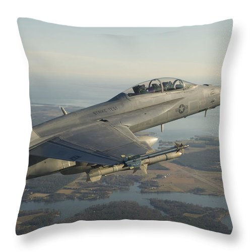 Military Throw Pillow featuring the photograph An Fa-18f Super Hornet Armed With An by Stocktrek Images