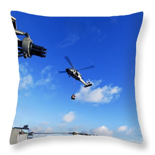 Military Sealift Command Throw Pillow featuring the photograph An Mh-60s Sea Hawk Helicopter by Stocktrek Images