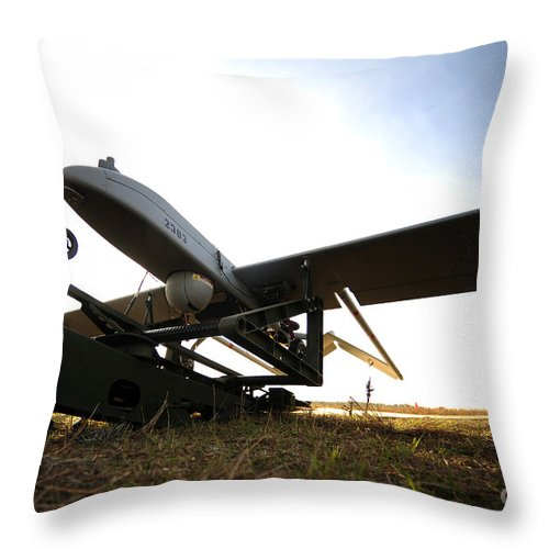 Catapult Throw Pillow featuring the photograph An Rq-7b Shadow Unmanned Aerial Vehicle by Stocktrek Images