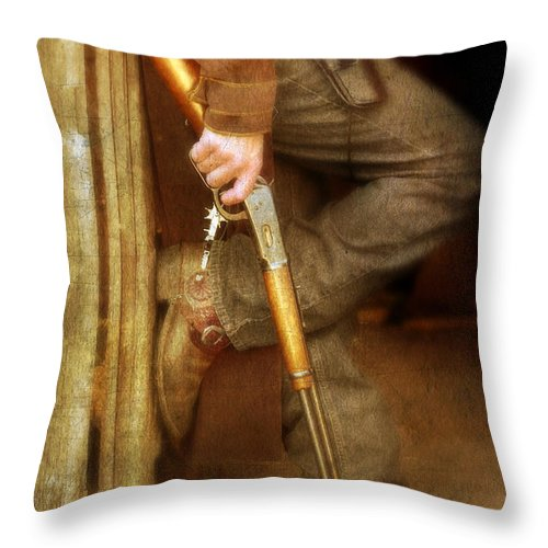 Cowboy Boots Throw Pillow featuring the photograph Cowboy With Guns by Jill Battaglia